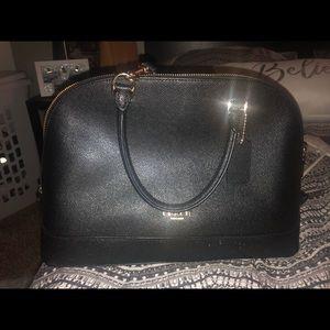 Coach bag and Michael Kors wallet